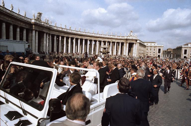 Pope John Paul II is helped by his bodyguards after being shot by Mehmet Ali Agca at St Peter's Square in Rome on May 13, 1981