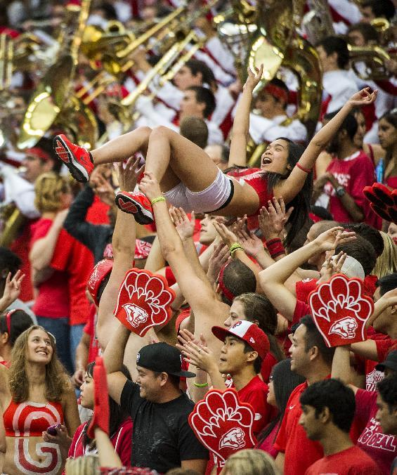 Fans in the Houston student section celebrate after a touchdown during the first half against Rice in an NCAA college football game Saturday, Sept. 21, 2013, in Houston. (AP Photo/Houston Chronicle, Smiley N. Pool)