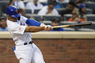 New York Mets' Francisco Lindor follows through on a two-run home run during the sixth inning in the first baseball game of a doubleheader against the Miami Marlins Tuesday, Sept. 28, 2021, in New York. The Mets won 5-2. (AP Photo/Frank Franklin II)