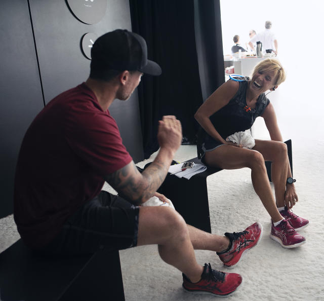 Liz McColgan and Wayne Bridge relax after the run. (Credit: ASICS).