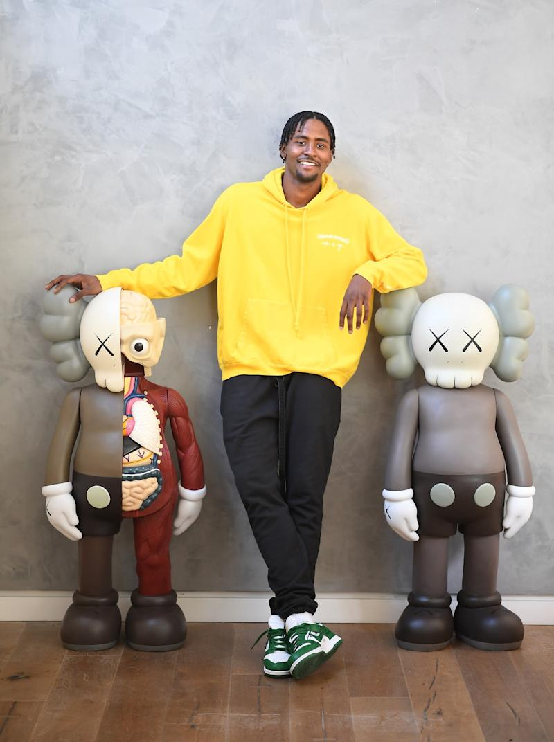 Maurice Harkless poses next to to a pair of KAWS figures at his home in Venice.