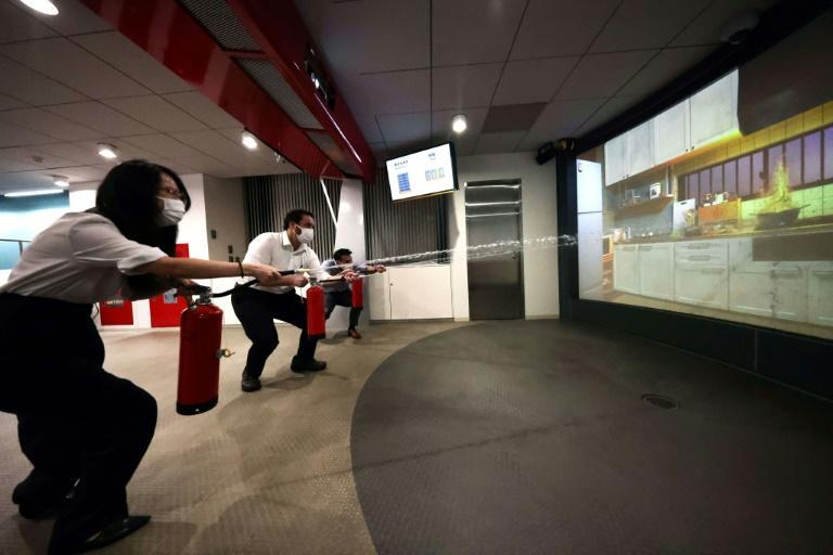 A disaster simulation course at Tokyo's Ikebukuro Life Safety Learning Centre teaches visitors how to use fire extinguishers