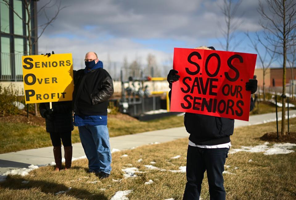 People protest outside the Tendercare Living Centre long-term-care facility during the COVID-19 pandemic in Scarborough, Ont., on Dec. 29, 2020. This LTC home has been hit hard by the coronavirus during the second wave.  (Photo: CP/Nathan Denette)