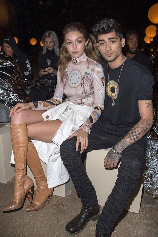 Gigi Hadid and Zayn Malik attend the Givenchy show at Paris Fashion Week in October 2016. (Photo: Stephane Cardinale – Corbis/Corbis via Getty Images)