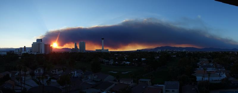 A smoke plume from the fires near Mount Charleston hangs over downtown Las Vegas on Monday July 8, 2013 and stretched dozens of miles. (AP Photo/Las Vegas Review-Journal, Norm Clarke)