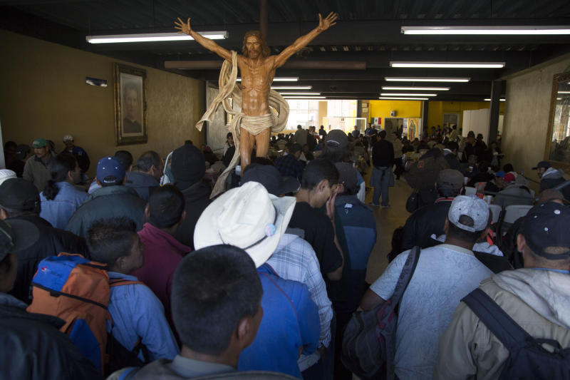 In this April 18, 2013, photo, migrants and recent deportees from the U.S. wait for a table at the dining room of the Padre Chava migrant shelter in the northern border city of Tijuana, Mexico. Deportations topped 400,000 in 2012, more than double from seven years earlier, sending Mexicans to border cities like Tijuana where they often struggle to find work. (AP Photo/Alex Cossio)
