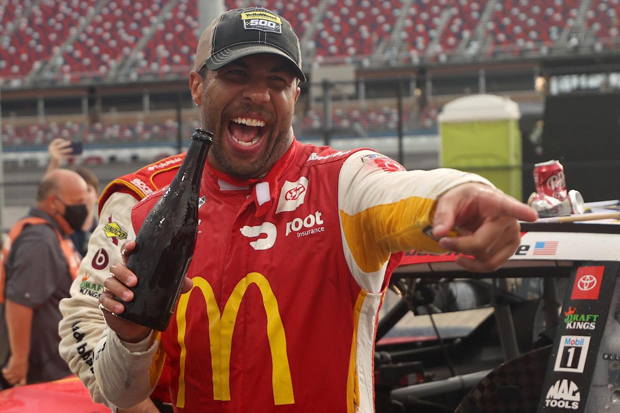 TALLADEGA, ALABAMA - OCTOBER 04: Bubba Wallace, driver of the #23 McDonald's Toyota, celebrates in the Ruoff Mortgage victory lane after winning the rain-shortened NASCAR Cup Series YellaWood 500 at Talladega Superspeedway on October 04, 2021 in Talladega, Alabama. (Photo by Chris Graythen/Getty Images)