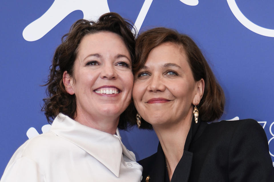 Olivia Colman, left, and Maggie Gyllenhaal pose for photographers at the photo call for the film 'The Lost Daughter' during the 78th edition of the Venice Film Festival in Venice, Italy, Friday, Sep, 3, 2021. (AP Photo/Domenico Stinellis)