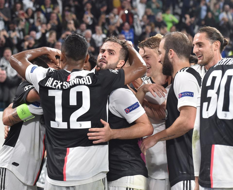 Juventus' Paulo Dybala celebrates with his teammates after scoring a goal during the UEFA Champions League group D soccer match against Lokomotiv Moscow at the Allianz Stadium in Turin, Italy, Tuesday, Oct. 22, 2019. (Andrea Di Marco/ANSA via AP)
