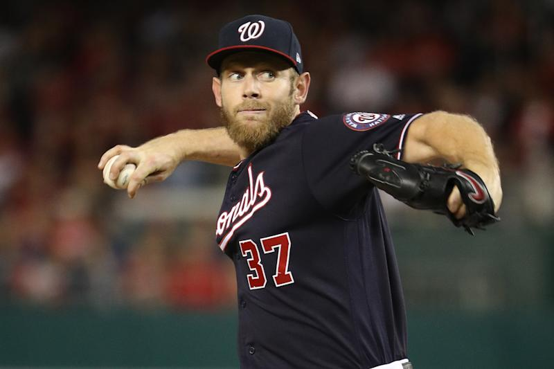 WASHINGTON, DC - OCTOBER 14: Stephen Strasburg #37 of the Washington Nationals pitches against the St. Louis Cardinals in game three of the National League Championship Series at Nationals Park on October 14, 2019 in Washington, DC. (Photo by Patrick Smith/Getty Images)