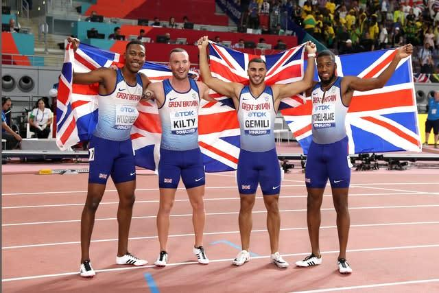 Zharnel Hughes, Richard Kilty, Adam Gemili, and Nethaneel Mitchell-Blake celebrate their medal (Mike Egerton/PA).