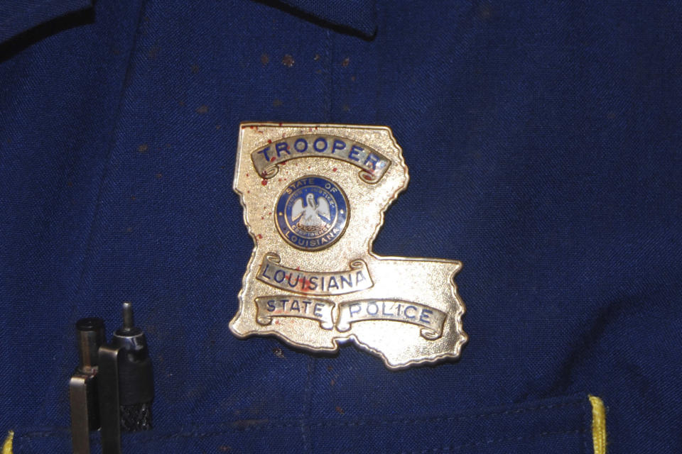 This May 10, 2019 photo provided by the Louisiana State Police shows blood stains on the shield and uniform of Master Trooper Chris Hollingsworth, in West Monroe, La., after troopers punched, dragged and stunned Black motorist Ronald Greene during his fatal 2019 arrest. (Louisiana State Police via AP)