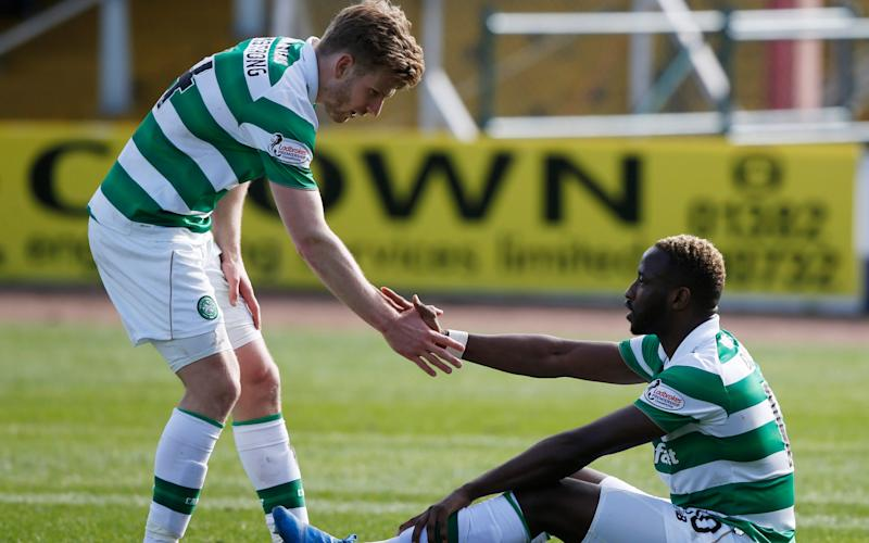 Moussa Dembélé was injured against Dundee two weeks ago - Credit: Reuters