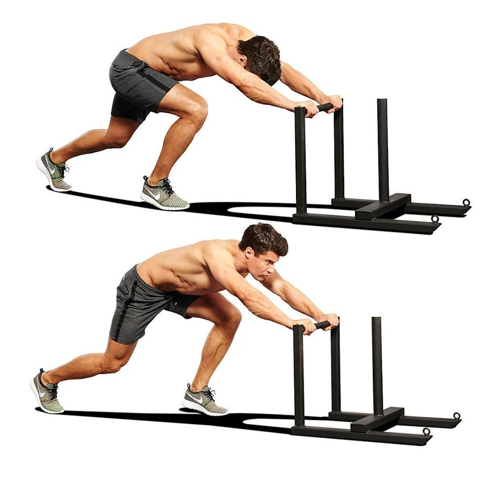 """<ol><li>Set up in an athletic stance with your torso almost parallel to the ground. </li><li>Gripping the pipes a third of the way down with your arms locked out, drive <a href=""""https://www.menshealth.com/uk/building-muscle/a758276/the-best-equipment-youre-not-using-the-prowler/"""" rel=""""nofollow noopener"""" target=""""_blank"""" data-ylk=""""slk:the sled"""" class=""""link rapid-noclick-resp"""">the sled</a> by marching forward as fast as you can, bringing one knee up to your chest as your other leg extends behind you. </li></ol>"""
