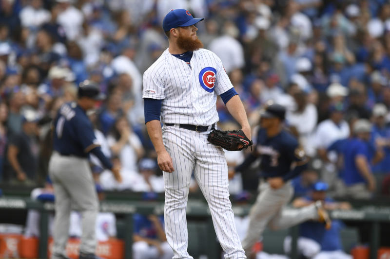 Chicago Cubs relief pitcher Craig Kimbrel watches a three-run home run hit by Milwaukee Brewers' Christian Yelich during the ninth inning of a baseball game Sunday, Sept. 1, 2019, in Chicago. (AP Photo/Paul Beaty)