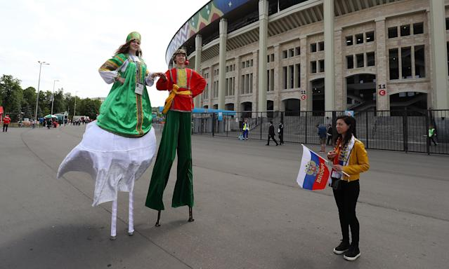 <p>Entertainers on stilts outside the stadium ahead of kick off<br> Russia v Saudi Arabia (Rex) </p>