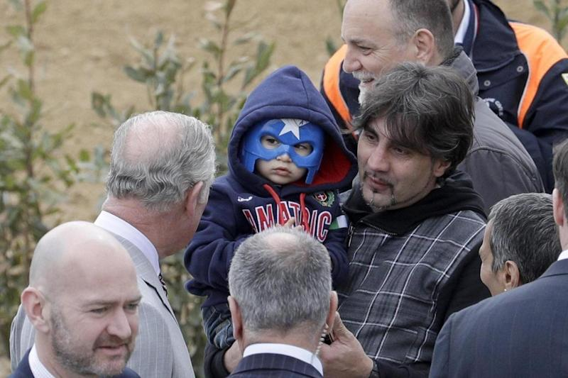 Quake: Charles met a young resident of the town (AP)