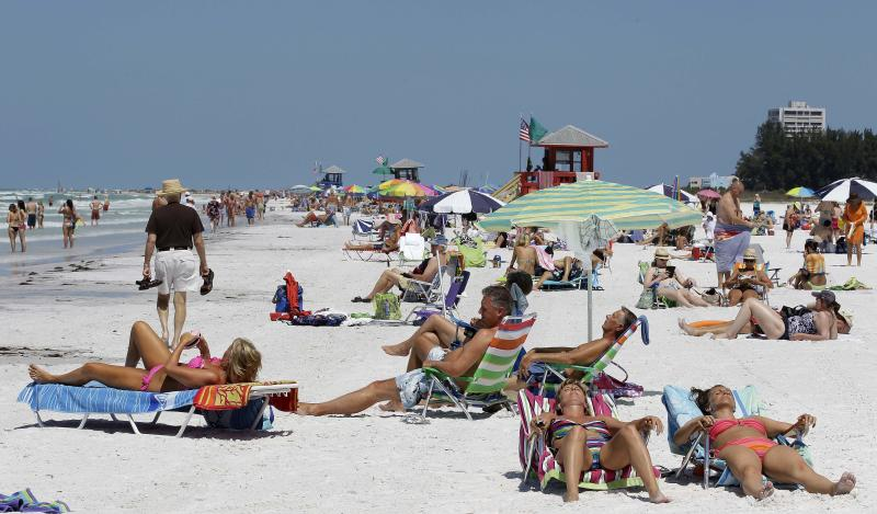"This May 18, 2011 photo, shows the Siesta Key public beach in Sarasota, Fla.  Siesta Key is on the list of Top 10 Beaches produced annually by coastal expert Stephen P. Leatherman, also known as ""Dr. Beach,"" director of Florida International University's Laboratory for Coastal Research. (AP Photo/Chris O'Meara)"