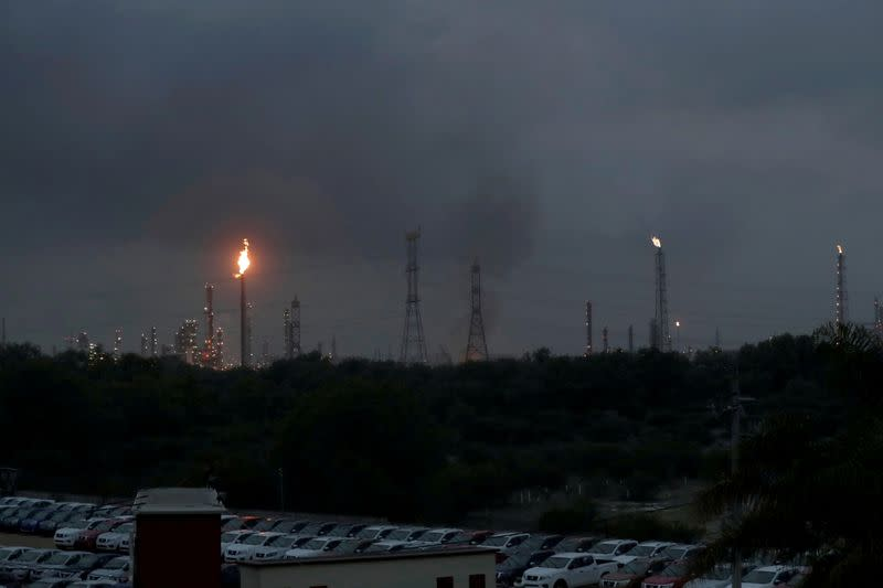 FILE PHOTO: Excess natural gas is burnt, or flared, from Mexican state-owned Pemex's Tula oil refinery, located adjacent to the Tula power plant belonging to national power company Comision Federal de Electricidad, or CFE, in Tula de Allende