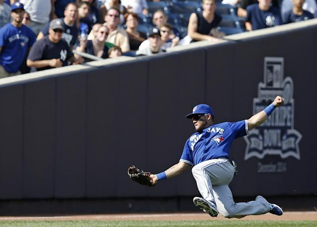 Toronto Blue Jays left fielder Melky Cabrera hauls in Ichiro Suzuki's ninth-inning flyout in a baseball game at Yankee Stadium in New York, Sunday, July 27, 2014. The Blue Jays defeated the Yankees 5-4. (AP Photo/Kathy Willens)