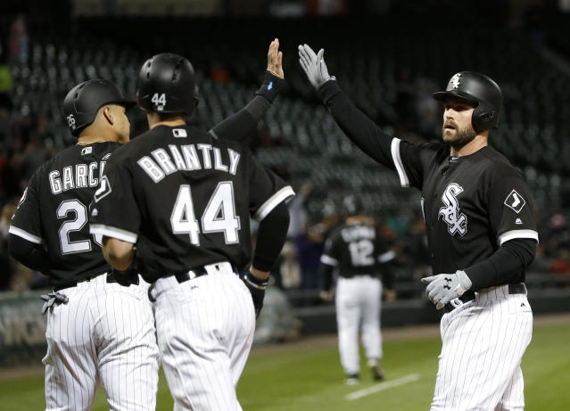 Chicago White Sox's Matt Davidson, right, celebrates his three-run home run off Cleveland Indians starting pitcher Danny Salazar with Avisail Garcia (26) and Rob Brantly during the first inning of a baseball game Tuesday, Sept. 5, 2017, in Chicago. (AP Photo/Charles Rex Arbogast)