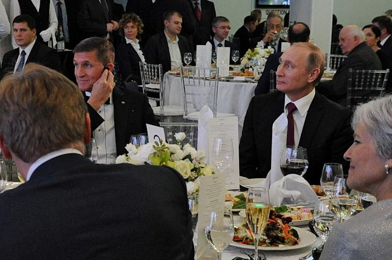 Vladimir Putin, right, with Michael Flynn