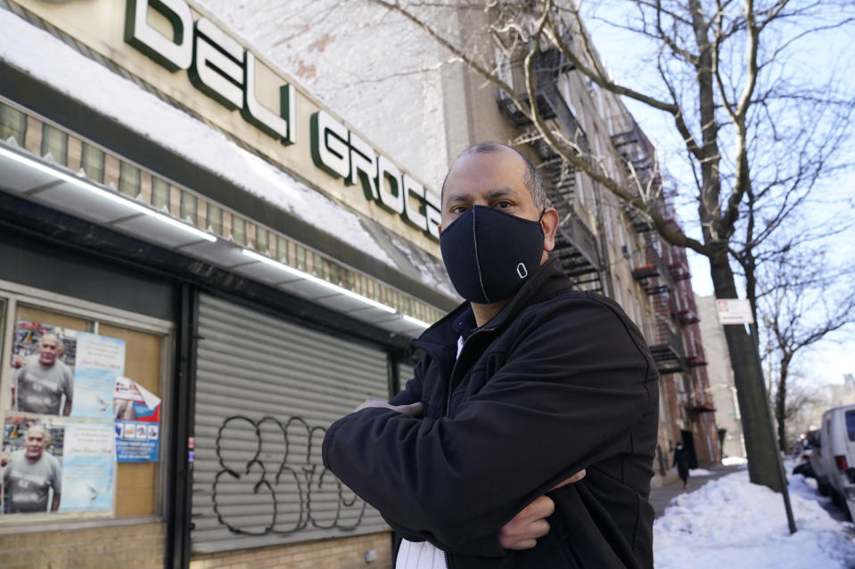 Bodega owner Frank Marté Wednesday, Feb. 10, 2021, in the Bronx borough of New York. Marté heads up the head of the Bodega and Small Business Group, which represents bodegas in New York. He said he has been lobbying local officials to set aside COVID-19 vaccine appointments for bodega workers, many of whom are unaware they are eligible. He hopes the recent opening of a large vaccination site at Yankee stadium will make access easier for people like him. (AP Photo/Kathy Willens)