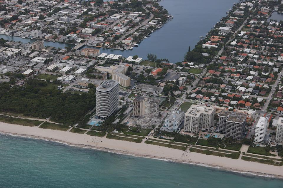 A portion of the 12-story condo tower crumbled to the ground June 24 in Surfside, Fla.