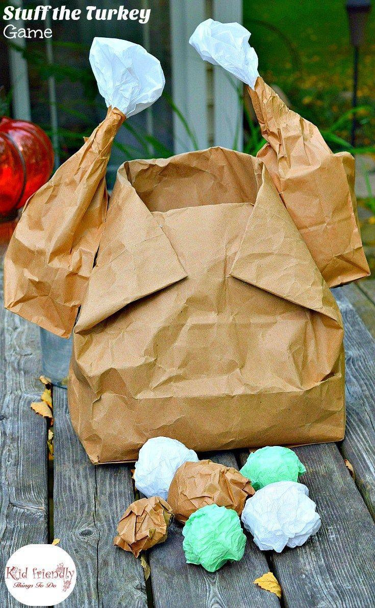 """<p>With a few twists, a large paper bag becomes a turkey — perfect for throwing balls of """"stuffing"""" into! It's like basketball, but tastier.</p><p><em><a href=""""http://kidfriendlythingstodo.com/2015/11/stuff-the-turkey-thanksgiving-game-for-kids/#_a5y_p=4571986"""" rel=""""nofollow noopener"""" target=""""_blank"""" data-ylk=""""slk:Get the tutorial at Kid Friendly Things To Do »"""" class=""""link rapid-noclick-resp"""">Get the tutorial at Kid Friendly Things To Do »</a></em><br></p>"""