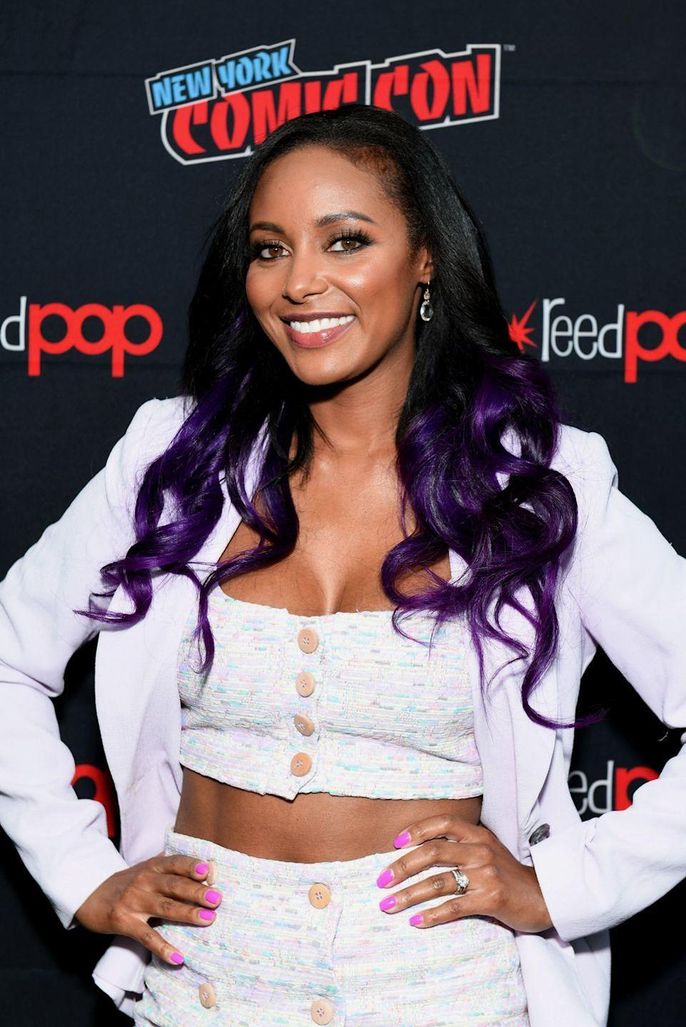 "<p>Add a bit of color to your curls with this pretty <a href=""https://www.goodhousekeeping.com/beauty/hair/g3029/purple-hair-color-ideas/"" rel=""nofollow noopener"" target=""_blank"" data-ylk=""slk:purple ombré"" class=""link rapid-noclick-resp"">purple ombré</a> style.</p>"