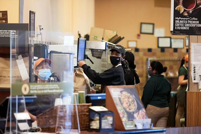 """Joseph readies a takeout order at Panera Bread café in Bay Shore, N.Y.<span class=""""copyright"""">Mohamed Sadek for TIME</span>"""