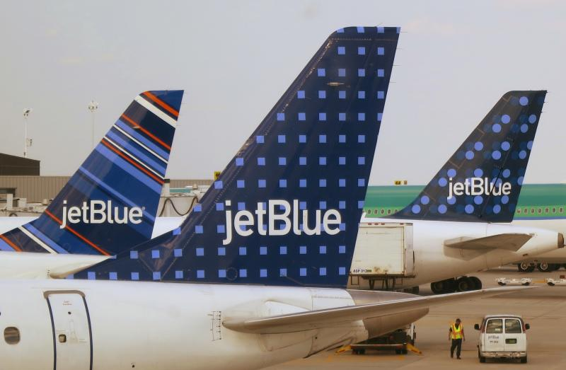JetBlue Airways aircraft are pictured at departure gates at John F. Kennedy International Airport in New York
