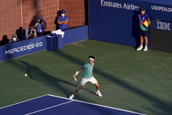 Kei Nishikori, of Japan, returns a shot to Mackenzie McDonald, of the United States, during the second round of the US Open tennis championships, Thursday, Sept. 2, 2021, in New York. (AP Photo/Frank Franklin II)