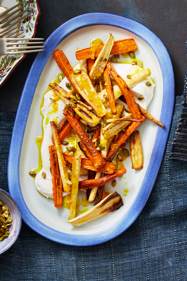 """<p>This classic side dish gets and Indian-inspired twist with the addition of turmeric, allspice, and tangy Greek yogurt. Serve it up with your holiday spread, or pop them in the oven to elevate any weeknight dinner.</p><p><a href=""""https://www.prevention.com/food-nutrition/recipes/a24743348/roasted-carrots-and-parsnips-recipe/"""" rel=""""nofollow noopener"""" target=""""_blank"""" data-ylk=""""slk:Get the recipe »"""" class=""""link rapid-noclick-resp""""><strong><em>Get the recipe »</em></strong></a></p>"""