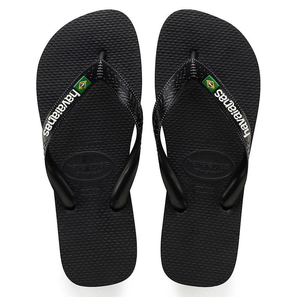 """<p><strong>HAVAIANAS</strong></p><p>nordstrom.com</p><p><strong>$26.00</strong></p><p><a href=""""https://go.redirectingat.com?id=74968X1596630&url=https%3A%2F%2Fshop.nordstrom.com%2Fs%2Fhavaianas-brazil-flip-flop-men%2F4856768&sref=https%3A%2F%2Fwww.menshealth.com%2Fstyle%2Fg21753744%2Fbeach-essentials%2F"""" rel=""""nofollow noopener"""" target=""""_blank"""" data-ylk=""""slk:BUY IT HERE"""" class=""""link rapid-noclick-resp"""">BUY IT HERE</a></p><p>Brazilians have mastered the art of effortlessly cool beach style. Don't leave home without your go-to Havaianas flip-flops for their lightweight feel and comfortable footbeds.</p>"""