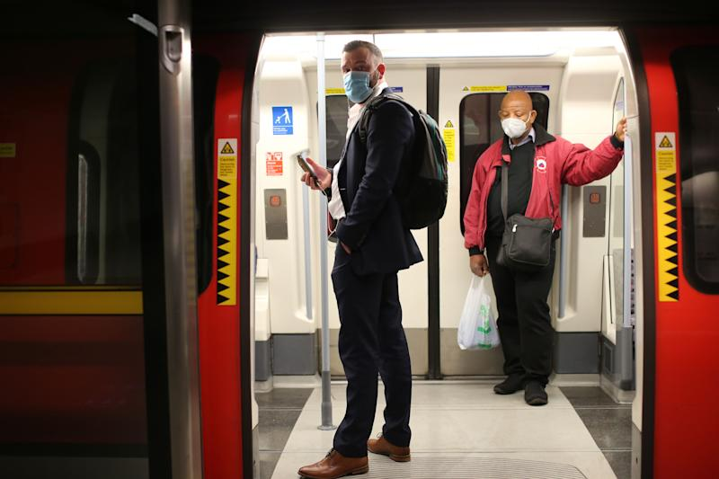 "Passengers wearing PPE (personal protective equipment), including face masks as a precautionary measure against COVID-19, travel on a London Underground Tube train, in the evening rush hour at Waterloo station on May 11, 2020, as life in Britain continues during the nationwide lockdown due to the novel coronavirus pandemic. - The British government on Monday published what it said was a ""cautious roadmap"" to ease the seven-week coronavirus lockdown in England, notably recommending people wear facemasks in some public settings. But the devolved governments in Scotland and Wales have opted for a more cautious approach, keeping the strictest stay-at-home measures in place to contain the outbreak. (Photo by ISABEL INFANTES / AFP) (Photo by ISABEL INFANTES/AFP via Getty Images)"