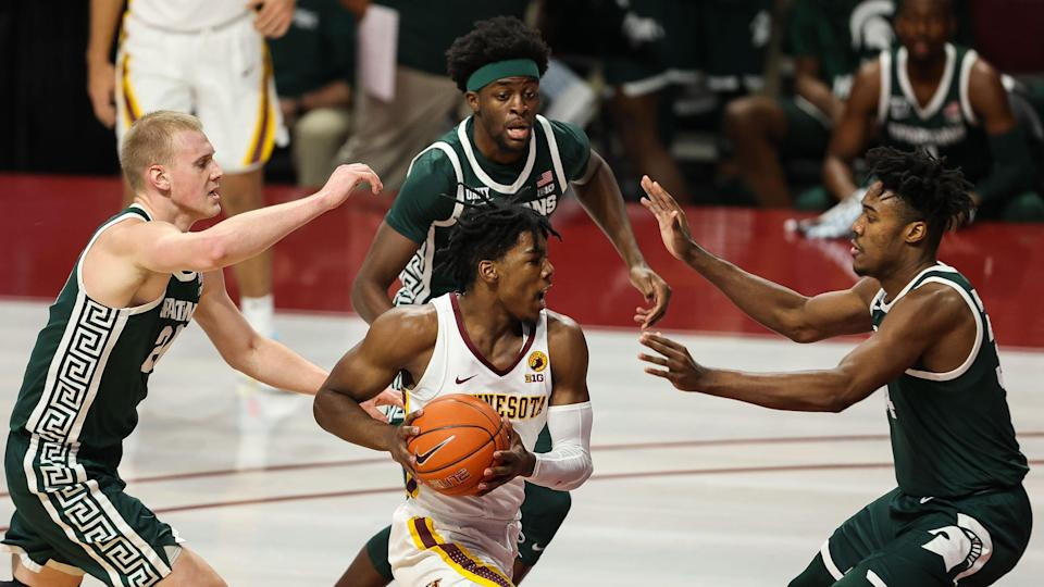Dec 28, 2020; Minneapolis, Minnesota, USA; Minnesota Gophers guard Marcus Carr (5) drives to the basket as Michigan State Spartans players guard him during the first half at Williams Arena. Mandatory Credit: Harrison Barden-USA TODAY Sports