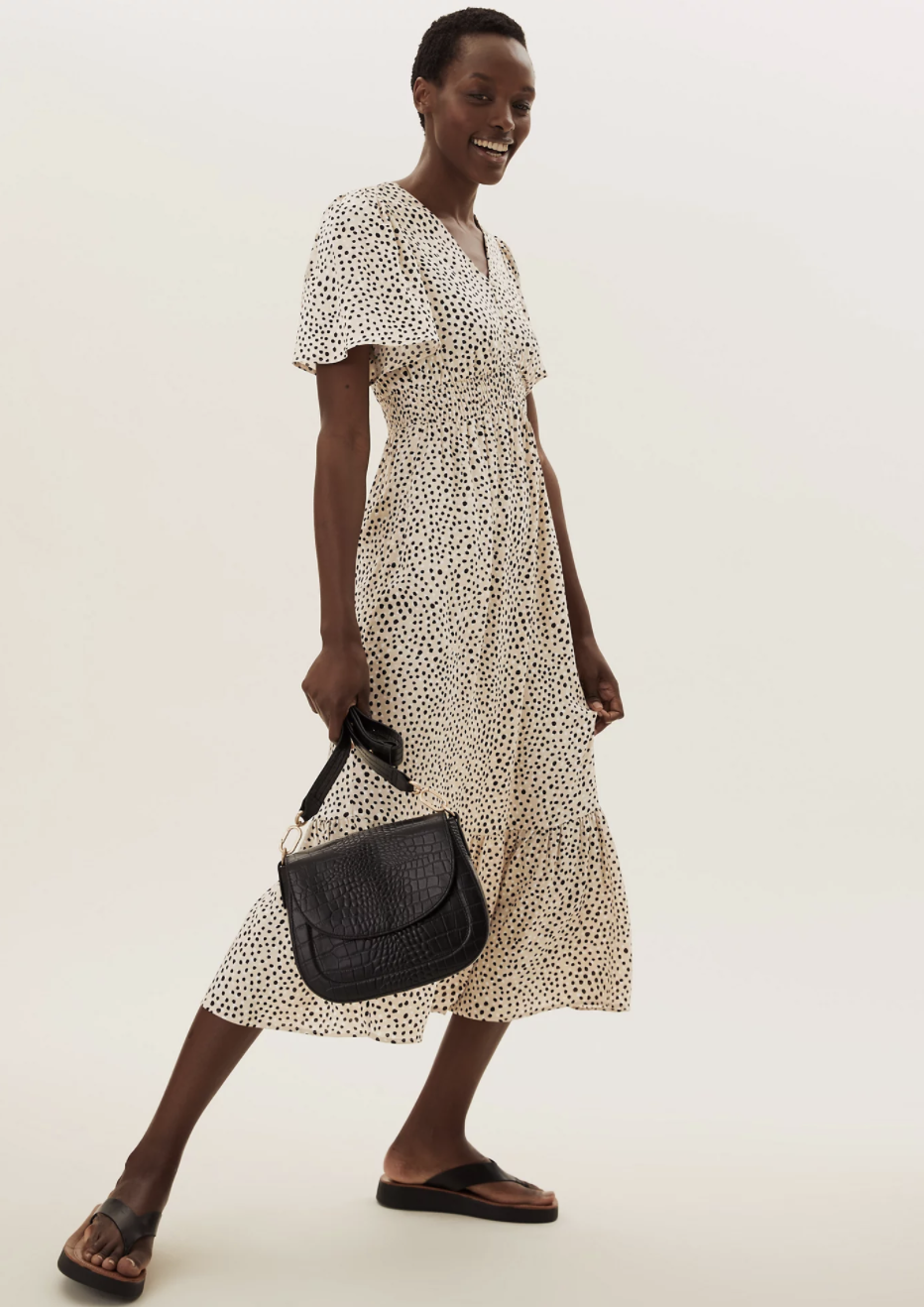 The Spot Print V Neck Midi Dress also comes in a blue colourway, which has almost sold out.  (Marks and Spencer)