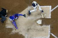 Milwaukee Brewers' Corbin Burnes hits an two-run scoring single during the sixth inning of a baseball game against the Chicago Cubs Wednesday, April 14, 2021, in Milwaukee. (AP Photo/Morry Gash)