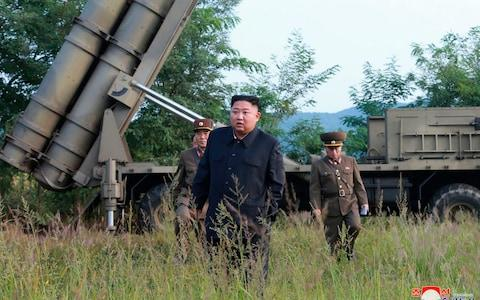 Kim Jong-un inspects the testing of a multiple rocket launcher system in September - Credit: KCNA via KNS/AP