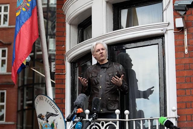 Julian Assange speaks from the balcony of the Ecuadorian Embassy in May 2017 following Sweden's dropping of sexual assault charges against the WikiLeaks founder. (Photo by Jack Taylor/Getty Images)