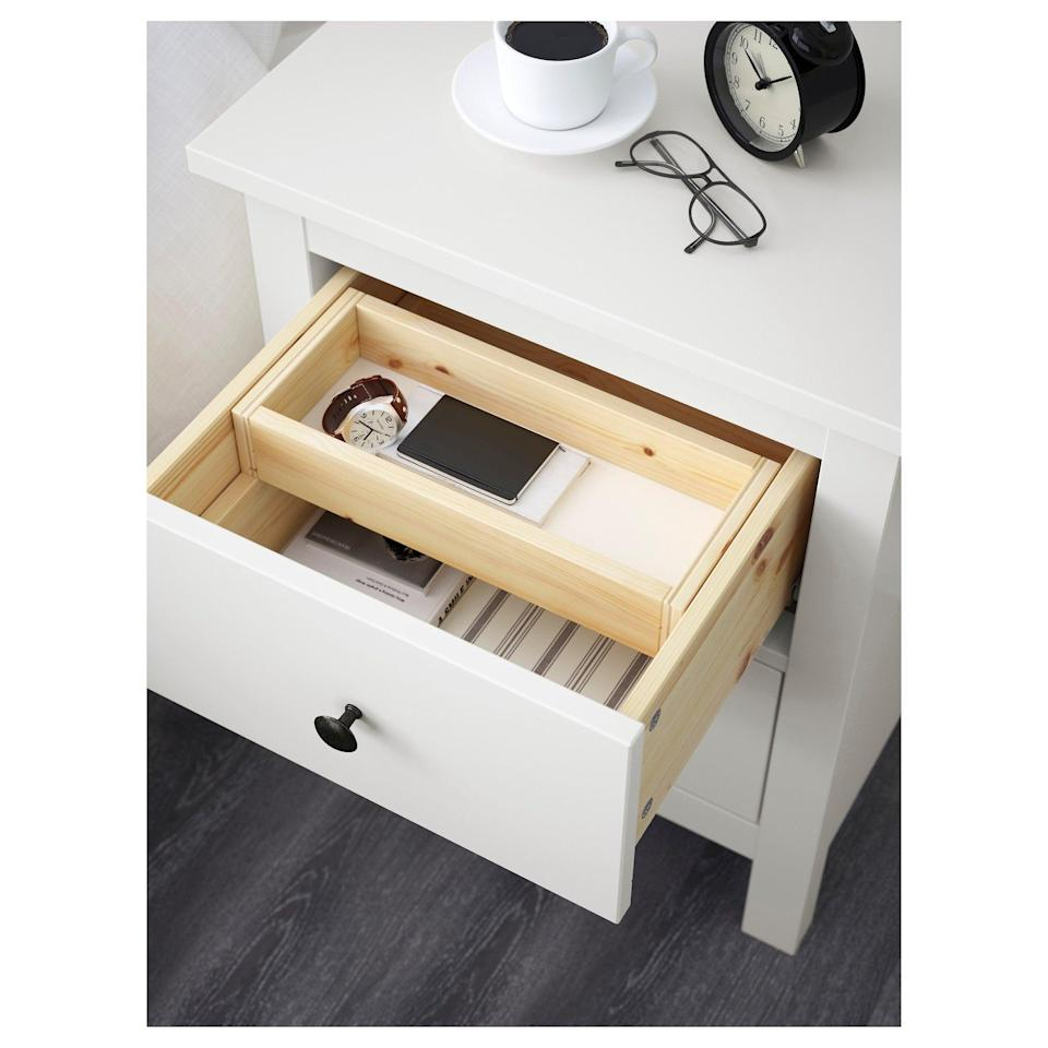 <p>The classic white paint and black hardware on the <span>Hemnes Two Drawer Chest </span> ($80) can blend with any style.</p>