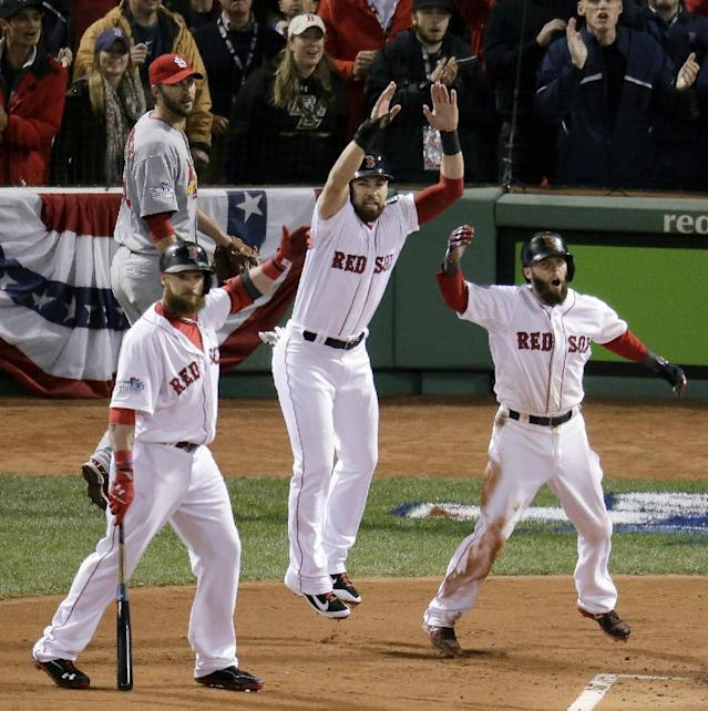 St. Louis Cardinals starting pitcher Adam Wainwright, left, rear watches as Boston Red Sox's Jonny Gomes, left, Jacoby Ellsbury, center, and Dustin Pedroia, celebrate a three-run scoring double by Mike Napoli during the first inning of Game 1 of baseball's World Series Wednesday, Oct. 23, 2013, in Boston. (AP Photo/Charlie Riedel)