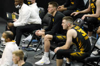Injured Iowa guard Joe Wieskamp, center, watches from the bench during the second half of an NCAA college basketball game against Wisconsin, Sunday, March 7, 2021, in Iowa City, Iowa. (AP Photo/Charlie Neibergall)