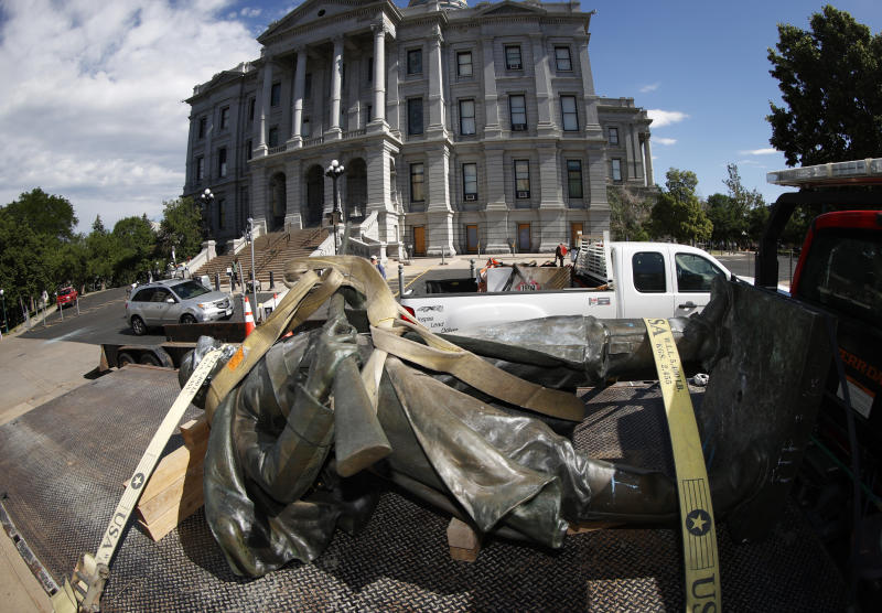 The Civil War Monument statue is strapped to the bed of a flatbed tow truck after it was toppled from its pedestal in front of the State Capitol Thursday, June 25, 2020, in Denver. The monument, which portrays a Union Army soldier and was erected in 1909, was targeted during demonstrations over the death of George Floyd before the statue was pulled down overnight by four individuals. (AP Photo/David Zalubowski)