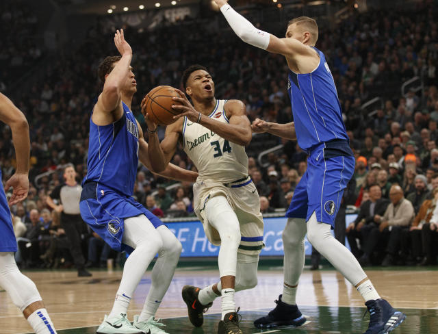 With Luka Doncic injured, Kristaps Porzingis, right, led Dallas to a big upset in Milwaukee. (Jeff Hanisch-USA Today)