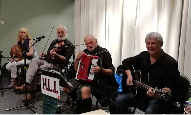 Robb is pictured second from left playing the fiddle with his wife Irene and other members of their band. (Supplied)