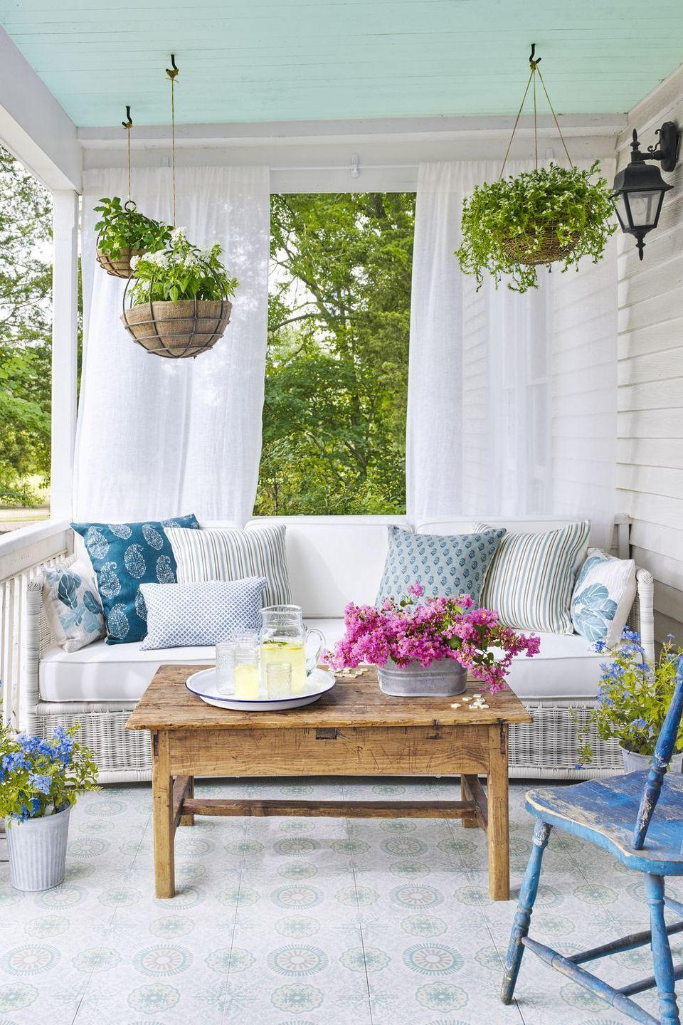 """<p>If you don't have space on the ground for the garden of your dreams, use <a href=""""https://www.goodhousekeeping.com/home/gardening/advice/g1007/backyard-decorating/?slide=18"""" rel=""""nofollow noopener"""" target=""""_blank"""" data-ylk=""""slk:porch ceilings"""" class=""""link rapid-noclick-resp"""">porch ceilings</a> to display your plant babies in hanging baskets.</p>"""