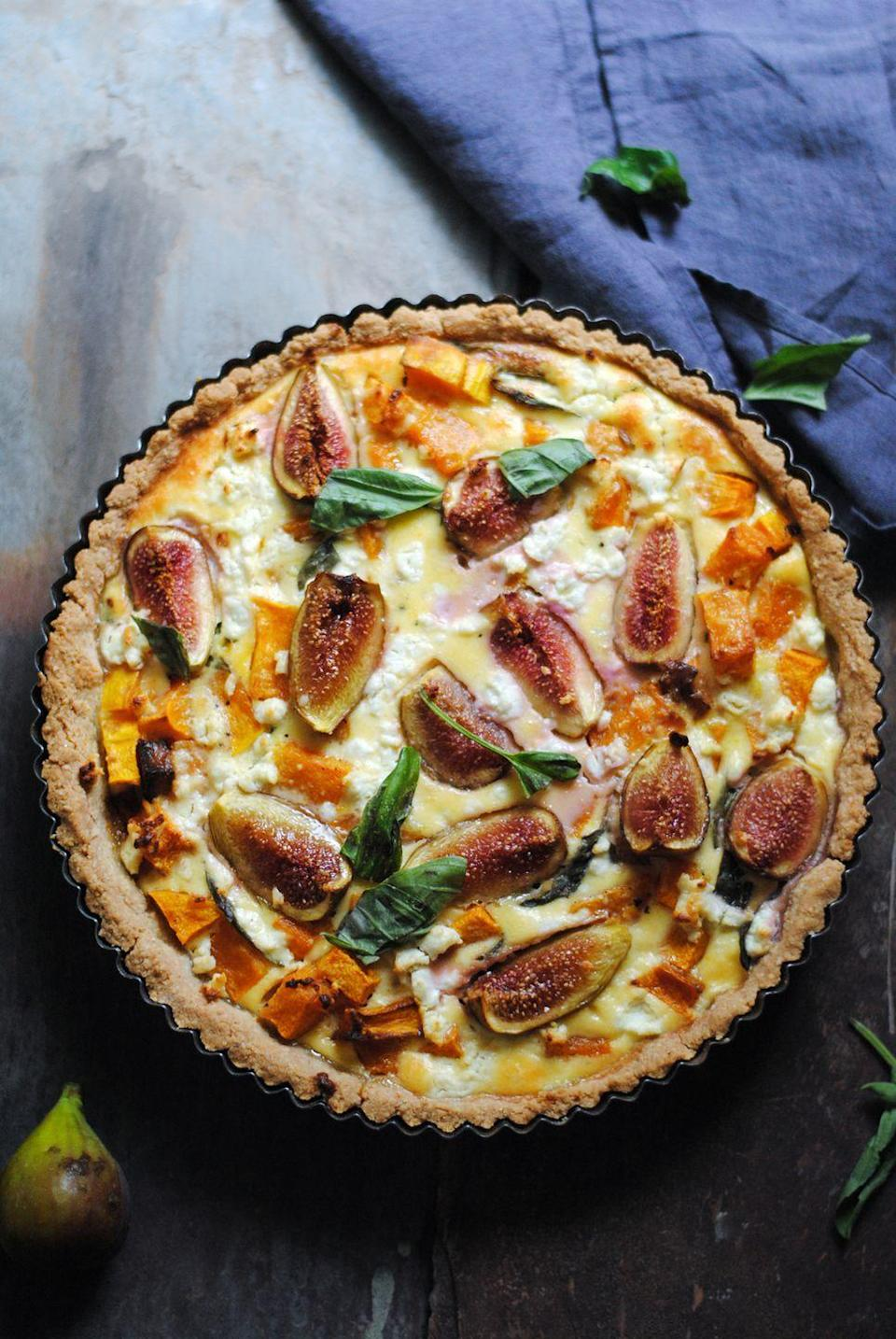 """<p>This mouthwatering blend of sweet and savory is baked with eggs, fig, pumpkin, and ricotta and goat cheeses. We seriously recommend it. </p><p><strong>Get the recipe at <a href=""""https://georgeats.com/recipes/fig-ricotta-basil-and-cheese-tarts-two-ways/"""" rel=""""nofollow noopener"""" target=""""_blank"""" data-ylk=""""slk:George Eats"""" class=""""link rapid-noclick-resp"""">George Eats</a></strong>. </p>"""