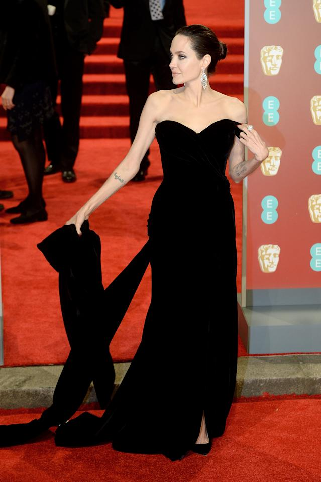 <p>Angelina walked the red carpet in a strapless gown by Ralph & Russo. <em>[Photo: Getty]</em> </p>